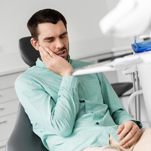 Man in dental chair for emergency dentistry