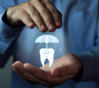 Hand holding an animated tooth under umbrella